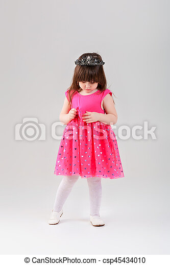 7ae02a655413 beautiful little girl in pink Princess dress with crown on gray -  csp45434010