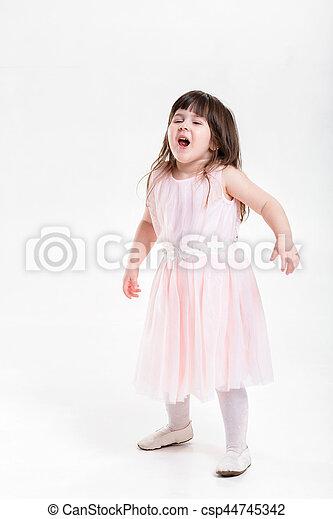 54ef2be762b6 beautiful little girl in pink Princess dress naughty on a gray b -  csp44745342