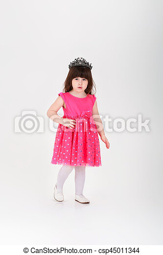 894b76eb47be beautiful little girl in pink Princess dress with crown on gray -  csp45011344