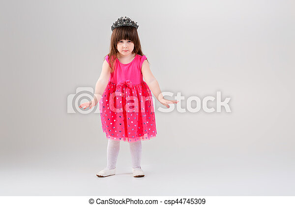 948947cfb8f9 Beautiful little girl in pink princess dress with crown trying t ...