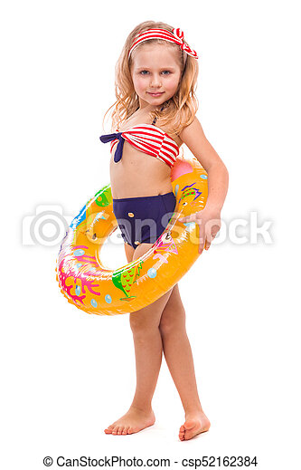 Beautiful little girl in red striped bikini, blue bottoms and pink wreath stand stand with colorful rubber ring on the waist - csp52162384