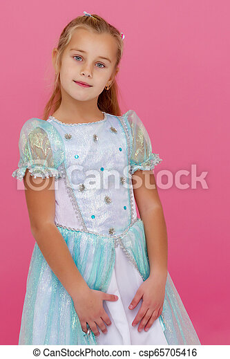Beautiful little girl on a pink background. - csp65705416
