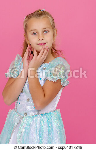 Beautiful little girl on a pink background. - csp64017249