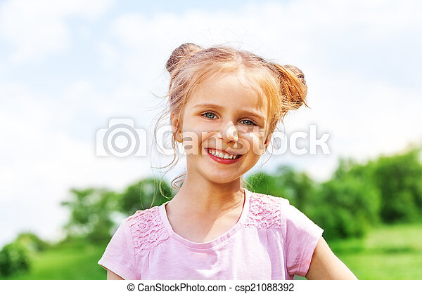 Beautiful little girl smiles at camera - csp21088392