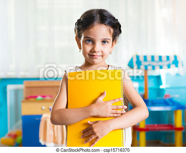 Beautiful little latin girl portrait in daycare - csp15716370