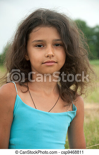 Beautiful long-haired girl in a field - csp9468811