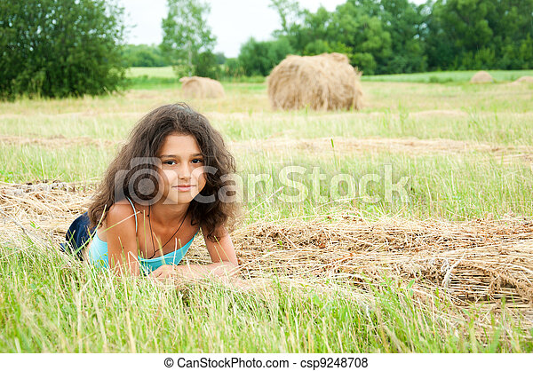 Beautiful long-haired girl in a field - csp9248708