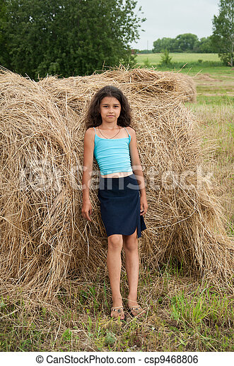 Beautiful long-haired girl in a field - csp9468806