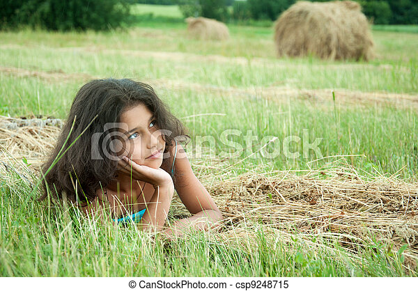 Beautiful long-haired girl in a field - csp9248715