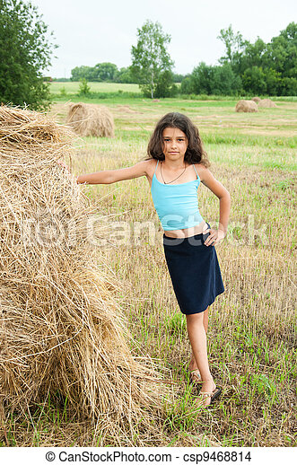 Beautiful long-haired girl in a field - csp9468814
