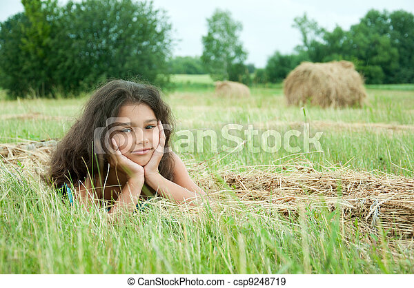 Beautiful long-haired girl in a field - csp9248719
