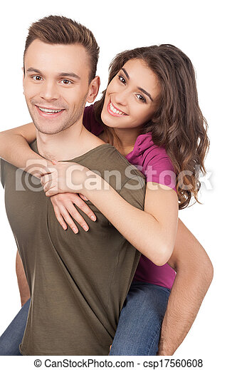 Beautiful loving couple. Cheerful young loving couple hugging and smiling at camera while standing isolated on white - csp17560608