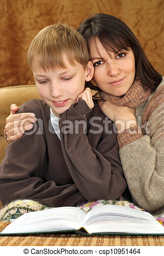 Beautiful luck Caucasian mother with her son reading a book - csp10951464