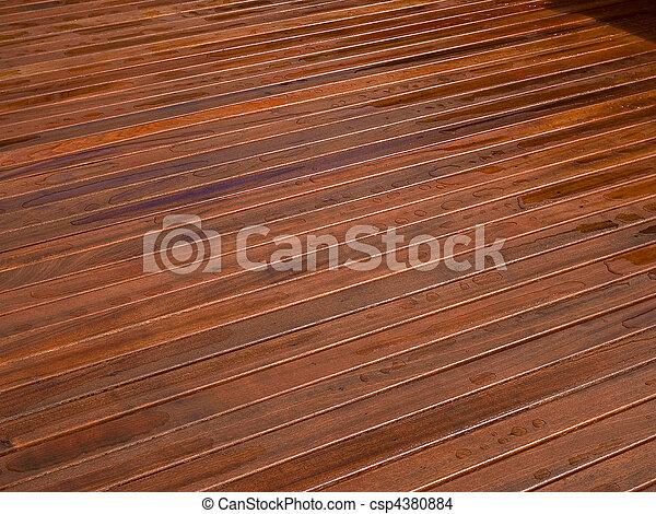 Beautiful mahogny hardwood deck floor - csp4380884