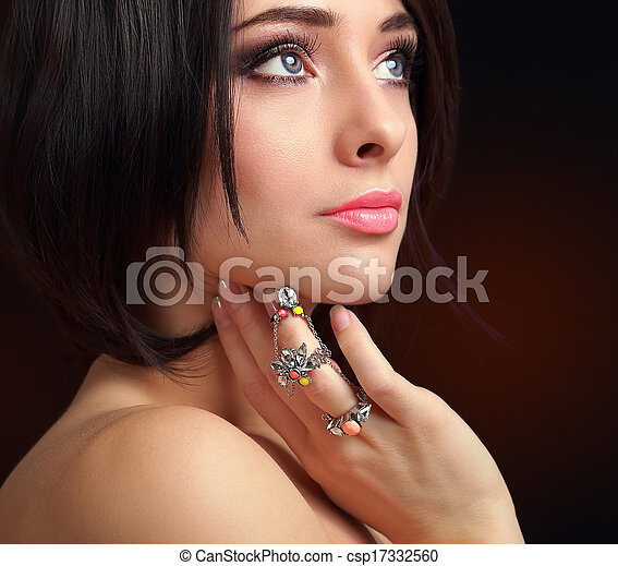 Beautiful makeup female face with ring on finger. Closeup portrait - csp17332560