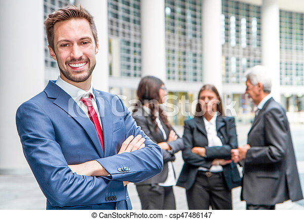 Beautiful man on the background of business people - csp47486147