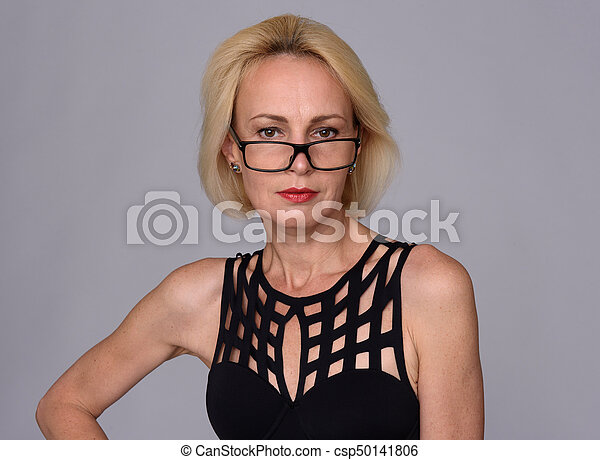middle aged woman nude wearing glasses