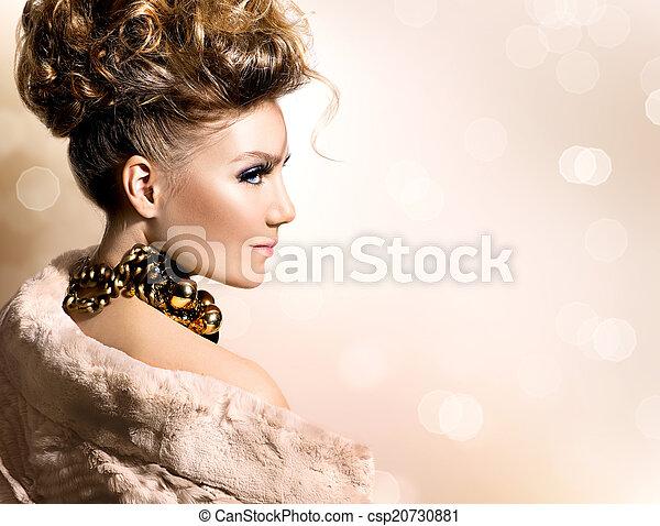 Beautiful model girl in luxury fur coat - csp20730881