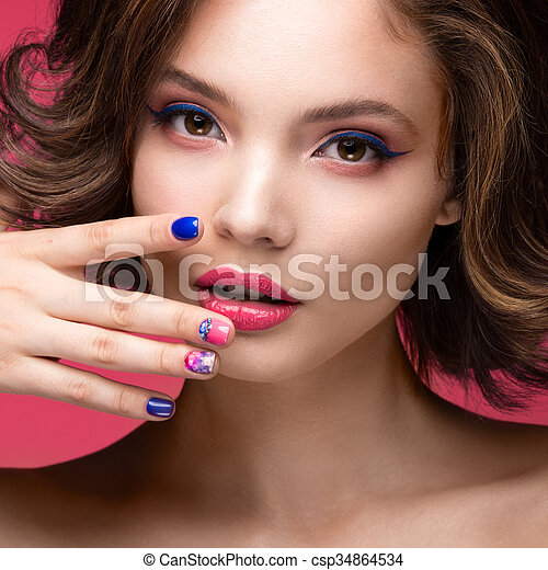 Beautiful model girl with bright pink makeup and colored nail polish ...