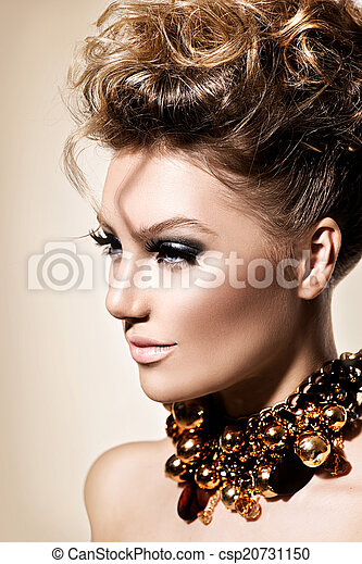Beautiful model girl with perfect fashion makeup and hairstyle - csp20731150