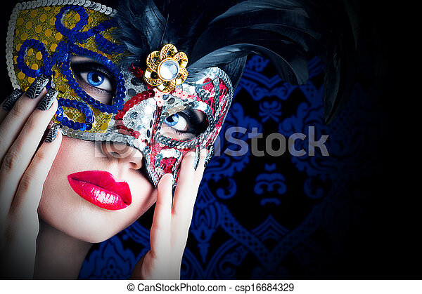 Beautiful model in carnival mask with red lips - csp16684329