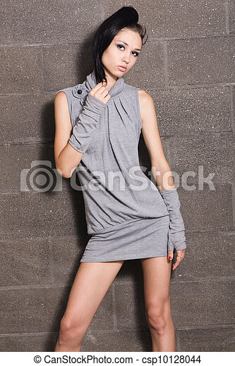 Beautiful model on bricks background - csp10128044