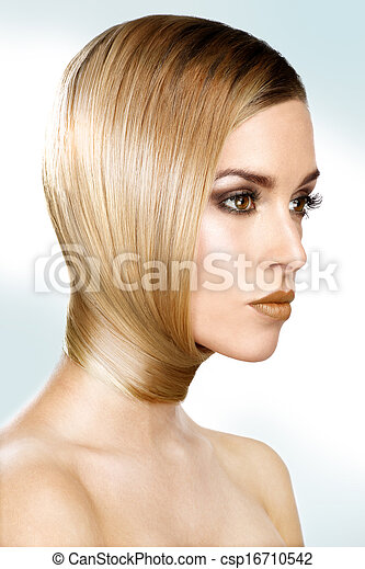 beautiful model showing her perfect blonde straight hair - csp16710542