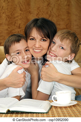 Beautiful mother and sons sitting - csp10952090