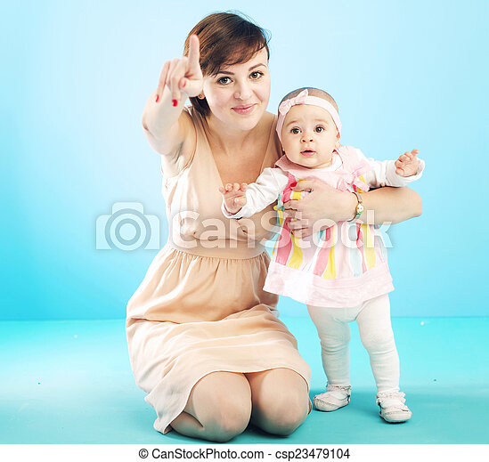 Beautiful mother with cute child - csp23479104