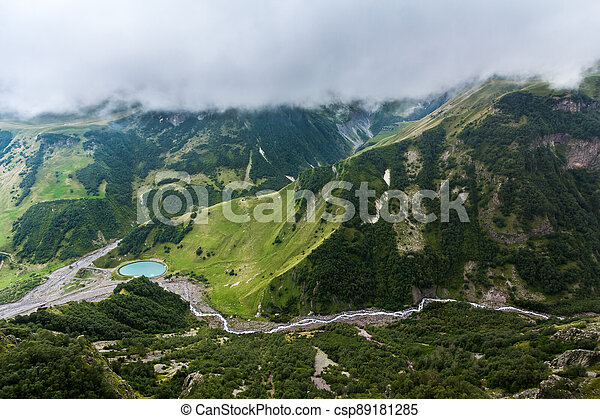 Beautiful mountain landscape with lake at dawn in the valley. - csp89181285