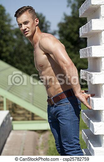 Beautiful muscular male model  - csp25782759