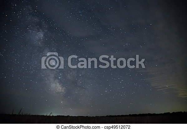 Beautiful night sky with stars. Milky Way over field - csp49512072