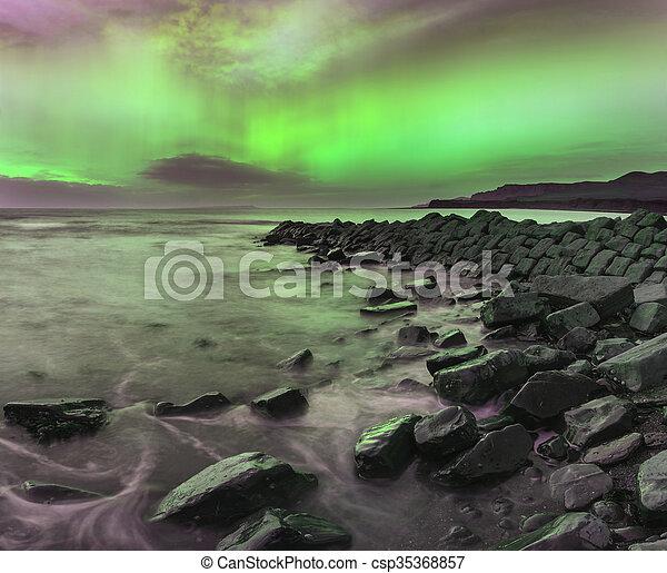 Beautiful Northern Lights Aurora Borealis over coastal landscape - csp35368857