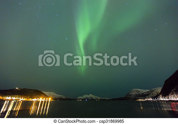 Beautiful northern lights over a fjord at night - csp31869985