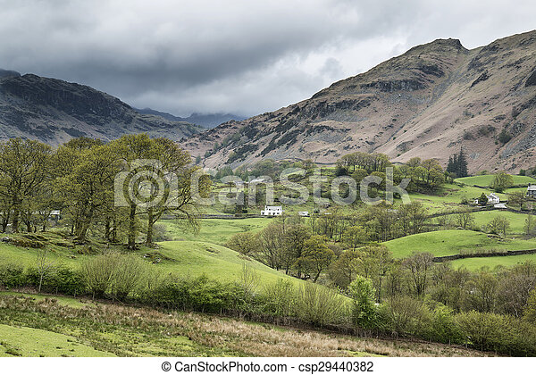 Beautiful old village landscape nestled in hills in Lake District - csp29440382