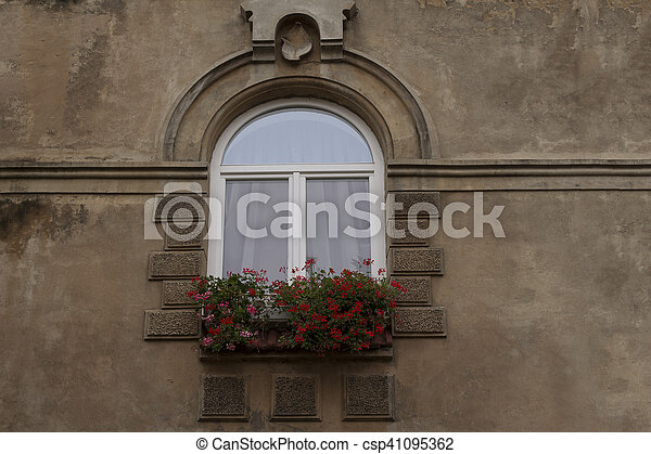 Beautiful old window with a flowers. Lviv, Ukraine - csp41095362