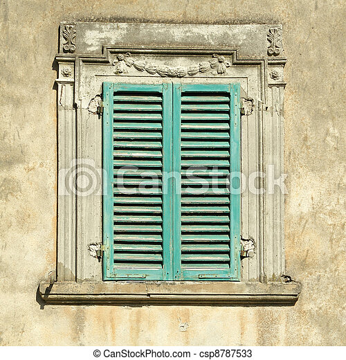 beautiful old window with green shutters - csp8787533