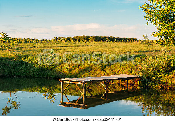 Beautiful Old Wooden Pier, Bridge For Fishing And Summer Forest In Background - csp82441701