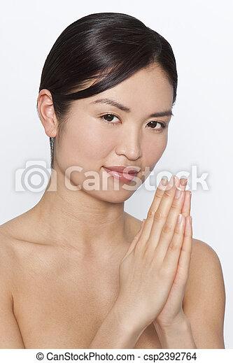 Beautiful Oriental Japanese Girl Praying Studio Shot Of A Beautiful