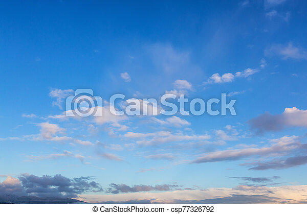 Beautiful Panoramic View of Cloudscape during a colorful winter sunset - csp77326792