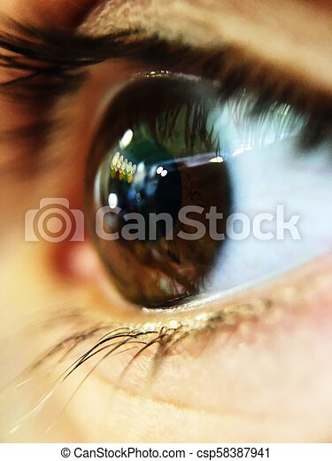 Beautiful photo of brown eyes with eyelashes close up - csp58387941