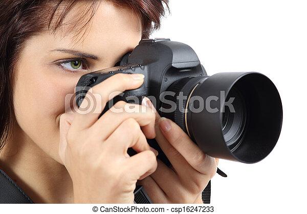 Beautiful photographer woman holding a digital camera - csp16247233