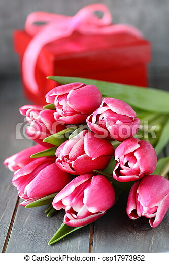 Beautiful pink tulips with gift box on wooden background - csp17973952