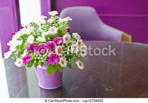 Beautiful plastic flowers in metal vase with copy space. - csp12794920
