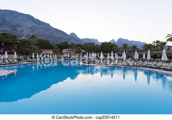 Beautiful pool on background of mountains in the evening - csp23014211