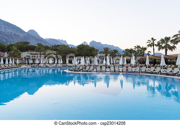 Beautiful pool on background of mountains in the evening - csp23014208