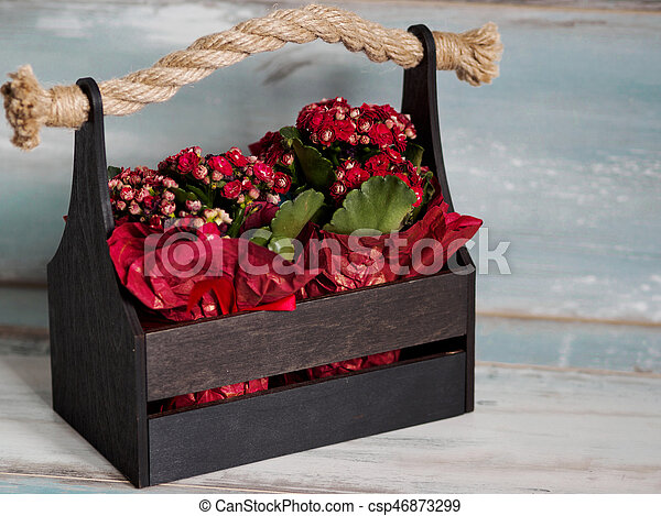 Beautiful pot of flowers wrapped in red paper gift in a wooden beautiful pot of flowers wrapped in red paper gift in a wooden basket csp46873299 mightylinksfo