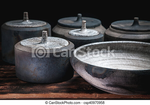 Beautiful pottery handmade on brown wooden background - csp40970958