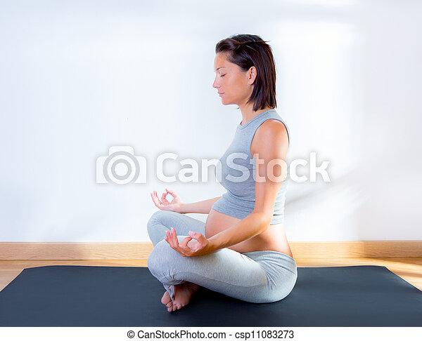 Beautiful pregnant woman at gym fitness yoga - csp11083273