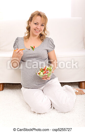 Beautiful pregnant woman eating salad - csp5255727